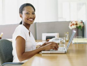side profile of a businesswoman using a laptop